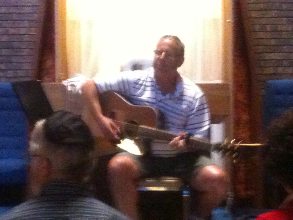 Dr. Dan playing guitar at a Kabbalat Shabbat service
